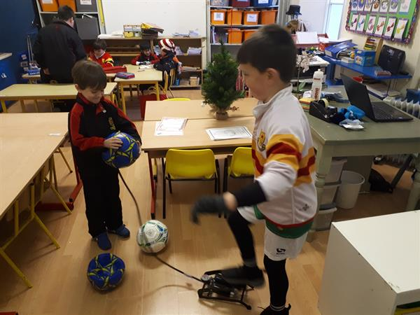 Luke and George doing the important task checking we have enough air in our footballs