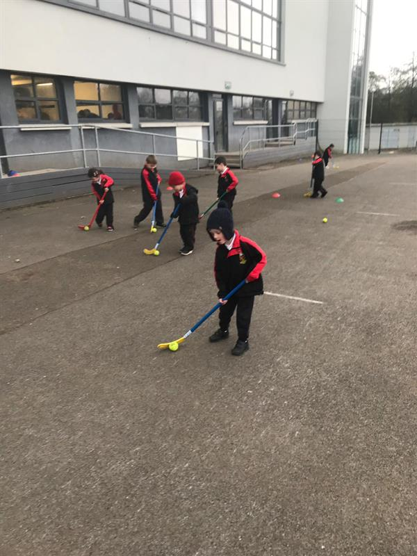 Learning how to do uni hockey in PE